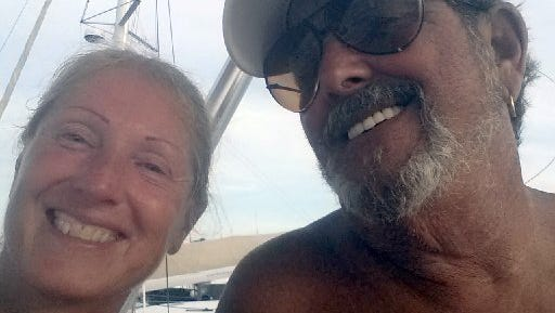 Bill Benton, left, and Elise Brown on their boat in Fort Pierce.