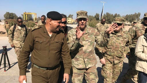 "U.S. Army Lt. Gen. Stephen Townsend talks with an Iraqi officer during a tour north of Baghdad, Iraq, Wednesday, Feb. 8, 2017. Forces fighting the Islamic State group should be able to retake the IS-held cities of Mosul in Iraq and Raqqa in Syria within the next six months, according to the top U.S. commander in Iraq. On a tour north of Baghdad Wednesday, Townsend said ""within the next six months I think we'll see both (the Mosul and Raqqa campaigns) conclude."""
