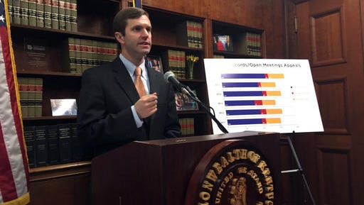 Kentucky Democratic Attorney General Andy Beshear speaks to reporters on Friday, Feb. 10, 2017, in Frankfort, Kentucky. Beshear and Republican Gov. Matt Bevin traded insults on Friday as they reignited their long simmering feud. (AP Photo/Adam Beam)