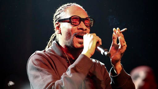 FILE - In this Tuesday, May 3, 2016, file photo, Snoop Dogg performs at Live Nation's National Concert Day at the Irving Plaza in New York. Kings of Leon, Snoop Dogg, Soundgarden and Sturgill Simpson are among the musical acts scheduled to perform at the Beale Street Music Festival in Memphis in May 2017, the Festival officials announced Wednesday, Feb. 22, 2017.