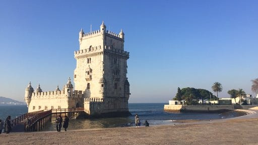 This Jan. 20, 2017 photo shows the Tower of Belem on the banks of the Tagus River in Lisbon, Portugal. The picturesque fortress is a UNESCO World Heritage site and one of Lisbon's most famous landmarks. It dates to the 16th century when Portuguese explorers sailed the globe, establishing a colonial empire that stretched from Asia to Africa to South America.