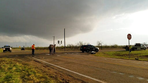 Texas Department of Public Safety troopers investigate a two-vehicle crash that killed three chasers near Spur in West Texas.