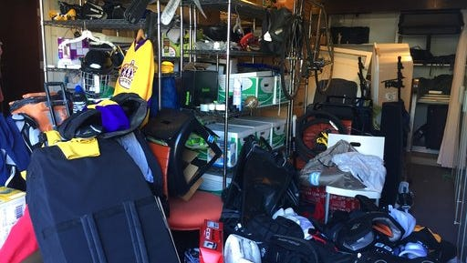 This undated photo provided by Regina Lark shows a garage organization project in Los Angeles, Calif. This image shows a garage before being organized to the client's goals.