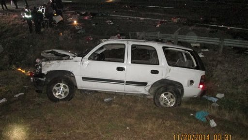 This photo provided by the Louisiana State Police shows the wreckage of a sport utility vehicle that was involved in an accident that killed five people in Calhoun, La., Thursday, Nov. 20, 2014. A 16-year-old boy driving relatives from Texas to a vacation in Disney World apparently fell asleep at the wheel, causing the vehicle to veer off the highway and roll over, killing three children and two adults, authorities said Thursday. (AP Photo/Louisiana State Police)