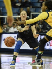 Nevada's T Moe passes the ball past UC Irvine's Morgan