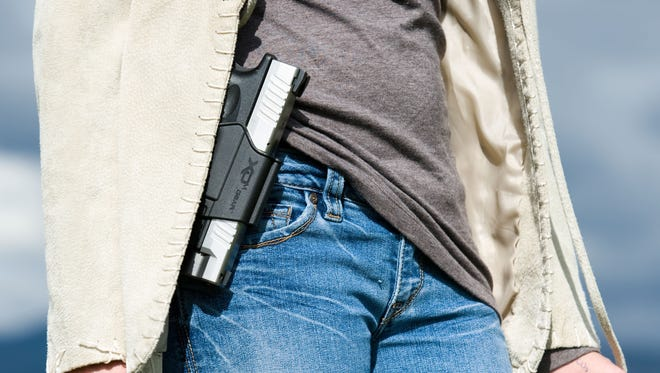 State law requires anyone carrying a concealed weapon to take a training course, undergo a background check and obtain a permit.