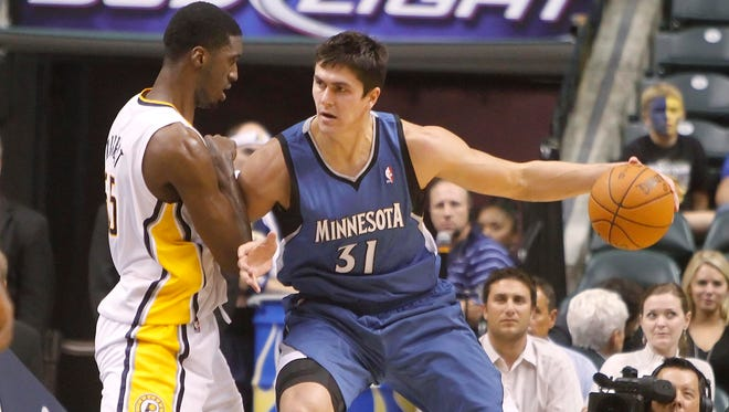 FILE - Former NBA player Darko Milicic, shown here backing down Pacers center Roy Hibbert in 2010, has quit basketball for kickboxing.