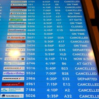 Flight cancellations are noted on a departure screen at Atlanta's Hartsfield-Jackson International Airport  on Feb. 25, 2015.