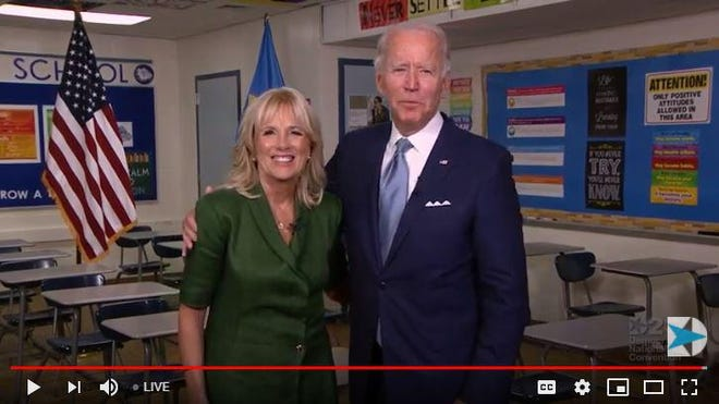 Democratic presidential nominee Joe Biden hugs wife Jill after she finishes her speech in a high school classroom where she once taught English. The video climaxed the second night of the party's 2020 mostly online convention.
