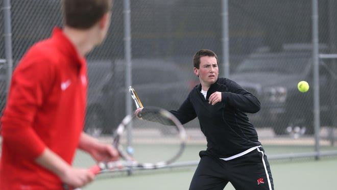 Kimberly's Alex Espanol gets ready to return the ball, while his doubles partner, Logan Manderle, watches at the Terror Invitational tennis tournament Saturday in Appleton.