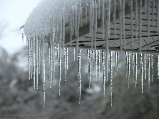 Icicles falling from a roof during winter