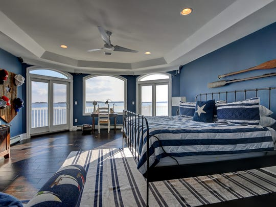 The master bedroom has a balcony overlooking the water.