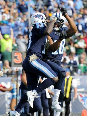 Titans wide receiver Rishard Matthews (18) celebrates with Titans wide receiver Kendall Wright (13) after Wright's touchdown against the Packers on Sunday.