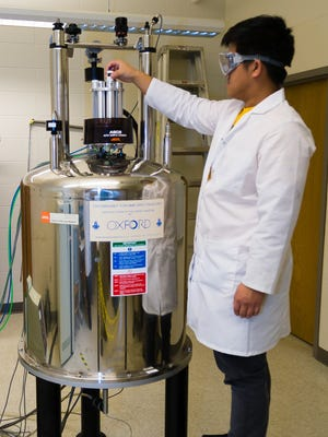 A student at the University of Wisconsin-Oshkosh uses the current Nuclear Magnetic Resonance spectrometer (NMR). The Chemistry Department announced it received a $355,000 grant to fund an upgraded NMR that will arrive on campus in 2017.