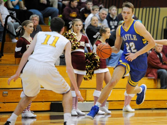 Castle's Jack Nunge (22) drives past Gibson Southern's Trey Riggs (11) during the Toyota Classic at Gibson Southern High School in Fort Branch, Monday, Dec. 19, 2016. Castle beat Gibson Southern 75-42.