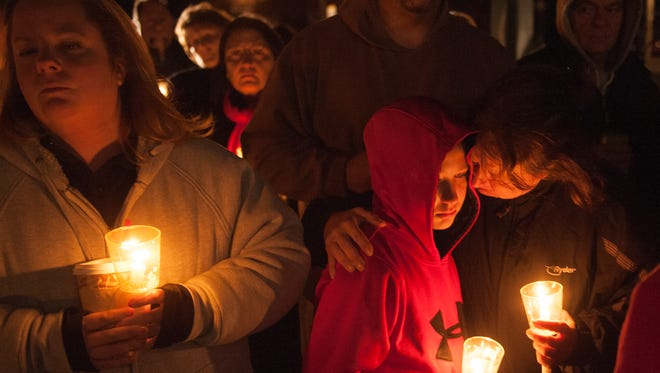 A large group takes part in a candlelight vigil held at Tabernacle Town Hall on Thursday evening for the victims of the Tabernacle shootings.
