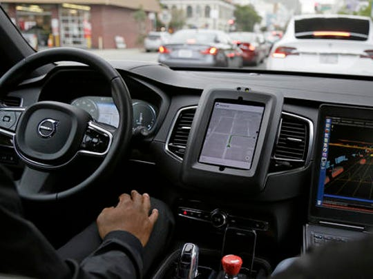 In this photo taken Tuesday, Dec. 13, 2016, an Uber driverless car waits in traffic during a test drive in San Francisco. Uber is bringing a small number of self-driving cars to its ride-hailing service in San Francisco - a move likely to both excite the city's tech-savvy population and spark a conflict with California regulators. The Wednesday, Dec. 14, launch in Uber's hometown expands a public pilot program the company started in Pittsburgh in September.