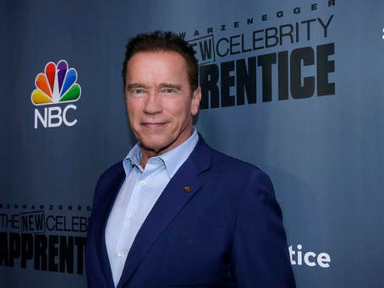 """This Dec. 9, 2016 image released by NBC shows Arnold Schwarzenegger, the new boss of """"The New Celebrity Apprentice,"""" at a press junket in Universal City, Calif."""
