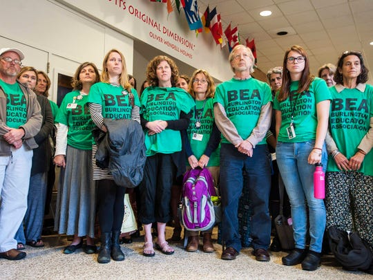 Burlington teachers listen as Fran Brock, president of the Burlington Education Association, not pictured, announces that the teachers have voted to strike if an agreement has not been reached with the school board by October 20th in Burlington on Thursday, October 13, 2016.