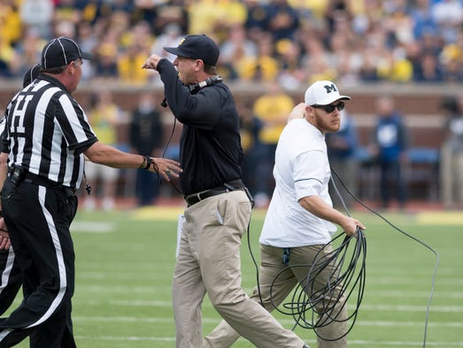 Michigan head coach Jim Harbaugh and Assistant Equipment