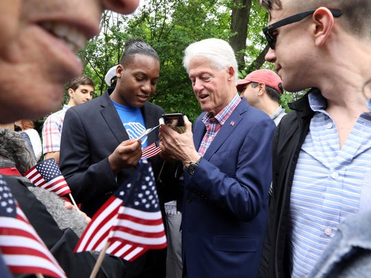 Former President Bill Clinton is greeted by the crowd before the New Castle Memorial Day Parade May 28, 2018.
