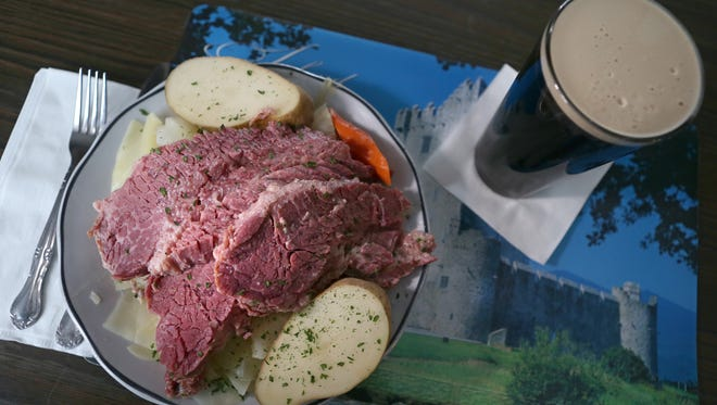A giant helping of corned beef and cabbage and potatoes served up with a pint of Guinness at McGinnity's.  The item is a popular special during the bar's St. Patrick's Day events.
