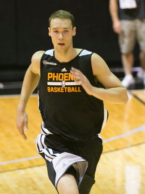 Prospective NBA draftee Alec Brown from Wisconsin Green Bay runs during a workout for prospective draftees at the practice court at the US Airways Center in Phoenix on Tuesday, May 27, 2014. The Suns selected Brown with a second-round draft pick in the 2014 draft.
