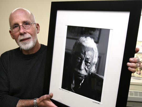 Pulitzer Prize winning photographer, Bill Foley, who is a full time adjunct professor of fine arts at Marian University, with a portrait he took of Gordon Parks, famed photographer, journalist, poet, film director, screenwriter, and composer.