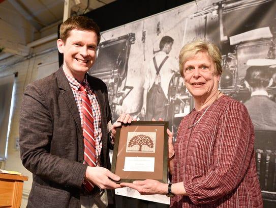 Barbara Mahoney accepts the David Duniway Historical