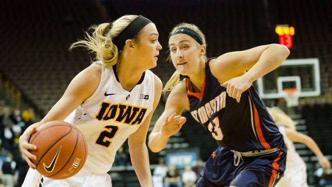Iowa's Ally Disterhoft drives against Tennessee-Martin's Haley Howard at Carver-Hawkeye Arena.