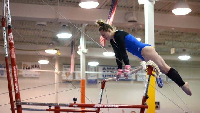 Hallie Roman performs on the uneven bars Monday, Feb. 22, during a gymnastics meet against Fraser at Kaleidoscope Gymnastics.