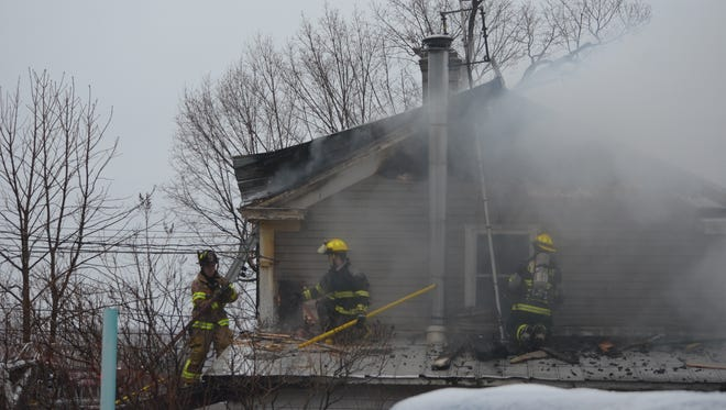 Firefighters from South Hero and Grand Isle fire departments beat down a fire Wednesday afternoon at a home in South Hero.