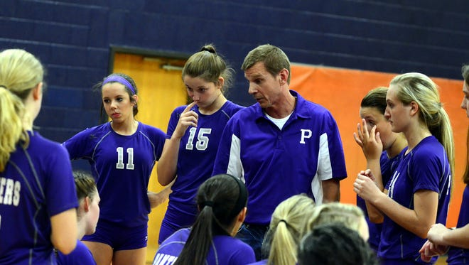 Portland head volleyball coach Rob Lesemann talks to his team during a match earlier this season. The Lady Panthers defeated Beech in three sets on Tuesday evening.