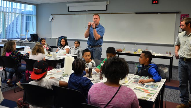 Carl Fedders, assistant public works director for the city of Battle Creek, teaches Verona Elementary School students about landfills on Friday.