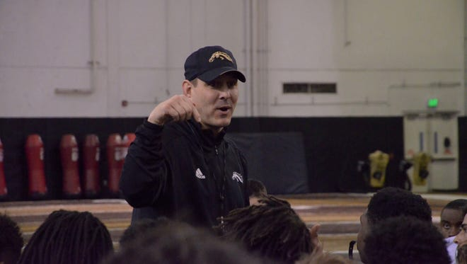 Western Michigan head coach Tim Lester speaks to his team at the Seelye Indoor Practice Facility in Kalamazoo, Michigan, on Feb. 20, 2018.