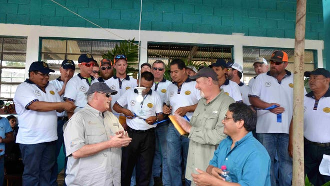 Crew members were presented with plaques at a celebration event in Las Tortugas to commemorate the delivery of electricity to the village