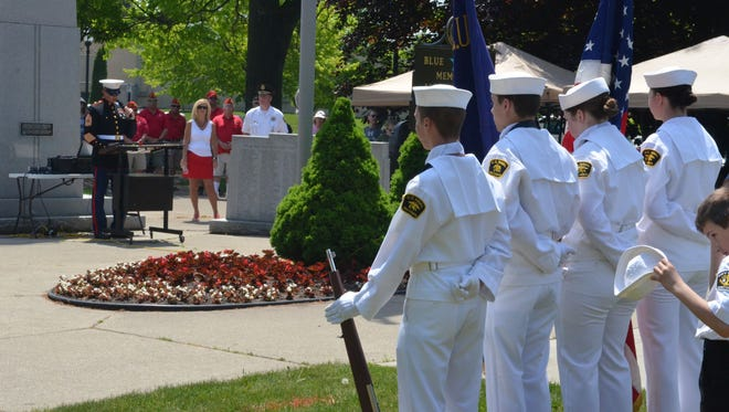 Left, St. Clair County Department of Veterans Affairs director Chris Smith speaks during a ceremony following the 2018 Port Huron Memorial Day Parade on May 28, 2018, in Port Huron, Michigan.