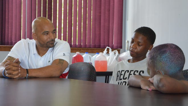 Damon Brown talks with Nasir Robertson during a mentoring session at the Urban League of Battle Creek.