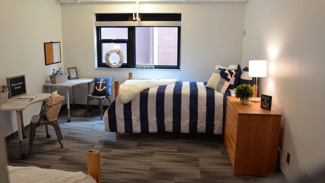 The Dock has 80 rooms which each sleep two residents. The rooms come furnishings including desks, chairs and stackable beds.