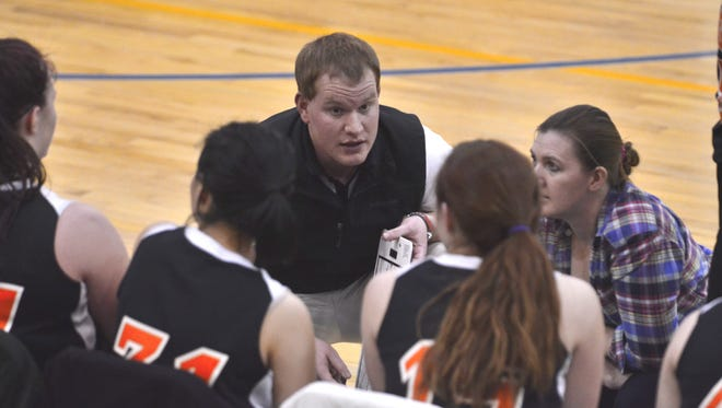 Opheim head coach Shane Bartschi addresses his team during a timeout at Scobey Tuesday.
