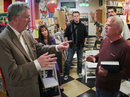 """Thomas Neuberger (left) talks with Michael Shulte, whose story is in his book """"When Priests Become Predators"""" at Ninth Street Books in Oct. 2012."""