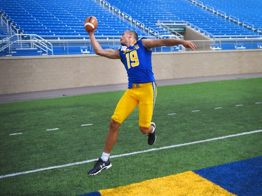 South Dakota State University wide receiver Jake Wieneke makes a one handed catch during media day Tuesday, Aug. 8, at Dana J. Dykhouse Stadium in Brookings.