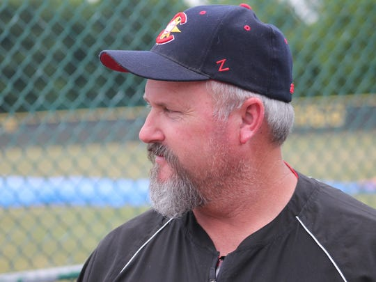 Harrison baseball coach Shawn Sowders helps with the