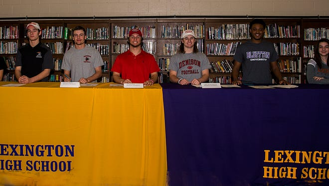 Seven Lexington High School athletes signed national letters of intent Thursday morning.