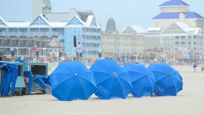 Rental umbrellas on the beach July 23, 2018, in Ocean City, Maryland, are tilted so they won't take off in a wind gust.