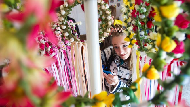 Abby Heinzen tries on traditional Polish flower wreaths during Polish Fest in 2015.