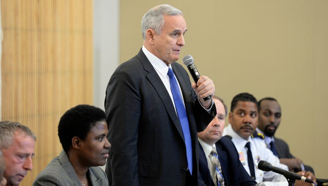 Gov. Mark Dayton answers questions  from a crowd gathered at the St. Cloud Public Library for a NAACP-sponsored discussion last October.