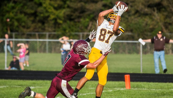 In this 2016 photo, Monroe Central's Nick Mitchell catches a pass for a touchdown against Wes-Del during their game at Wes-Del High School.