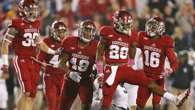 The Hoosiers defense celebrates stopping the Spartans from getting a first down during second half action against Michigan State, Saturday. The Hoosiers beat the Spartans in overtime, 24-21.