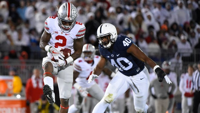 Ohio State wide receiver Dontre Wilson (2) catches a pass in front of Penn State linebacker Jason Cabinda (40) during the first quarter at Beaver Stadium.